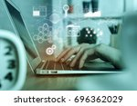 man using laptop at workplace... | Shutterstock . vector #696362029