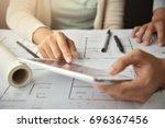 close up designers hands... | Shutterstock . vector #696367456