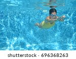 Young Girl Swimmer Swimming...
