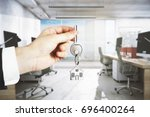 businessman hand holding key... | Shutterstock . vector #696400264