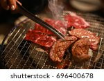 close up barbecue grilling cow... | Shutterstock . vector #696400678