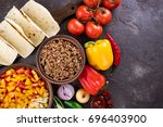 mexican tacos with vegetables... | Shutterstock . vector #696403900