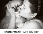 happy mature woman kisses... | Shutterstock . vector #696409489