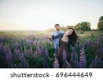 young couple in love walking ... | Shutterstock . vector #696444649