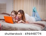 mom and daughter in glasses lie ... | Shutterstock . vector #696448774