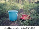 berry picking tools  a bucket... | Shutterstock . vector #696455488