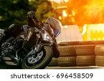 man riding sport motorcycle on... | Shutterstock . vector #696458509