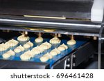 biscuit depositing machine ... | Shutterstock . vector #696461428