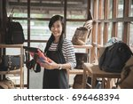 asian woman checking the... | Shutterstock . vector #696468394
