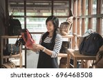 asian woman checking the... | Shutterstock . vector #696468508