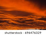 red voluminous clouds at... | Shutterstock . vector #696476329
