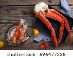 fresh crab claws on black... | Shutterstock . vector #696477238