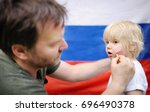 man drawing russian flag on... | Shutterstock . vector #696490378