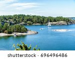 excursions by boat on a sunny... | Shutterstock . vector #696496486