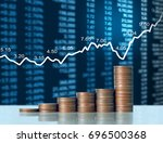 investment concept  coin graph... | Shutterstock . vector #696500368