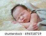 newborn baby girl is sleeping... | Shutterstock . vector #696518719