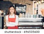 asian female barista wear red...   Shutterstock . vector #696535600