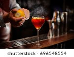 bartender is adding lemon zest... | Shutterstock . vector #696548554