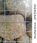 round boulders. fine grid. of... | Shutterstock . vector #696556543