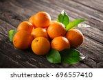 healthy orange fruits...   Shutterstock . vector #696557410
