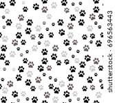 paw print seamless. traces of... | Shutterstock . vector #696563443
