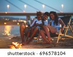 young mixed race family sitting ... | Shutterstock . vector #696578104