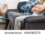 couple having fight in therapy... | Shutterstock . vector #696580270