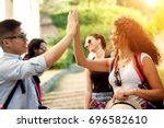 happy tourist friends are... | Shutterstock . vector #696582610
