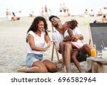 young mixed race family sitting ...   Shutterstock . vector #696582964