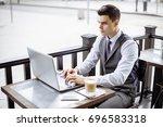 handsome businessman wearing... | Shutterstock . vector #696583318