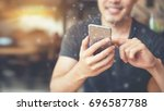 man hand using mobile phone ... | Shutterstock . vector #696587788