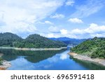 blue water in a forest lake... | Shutterstock . vector #696591418