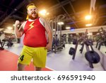 fat funny man winner smiles in... | Shutterstock . vector #696591940
