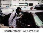 robber in black mask  robbery... | Shutterstock . vector #696596410