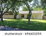 single family single story home   Shutterstock . vector #696601054