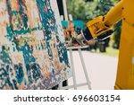 robot painter | Shutterstock . vector #696603154