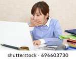 a surprised female office... | Shutterstock . vector #696603730