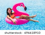 Girl On A Pink Flamingo In The...