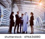 arab businessmen's handshake... | Shutterstock . vector #696636880