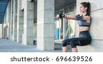young sporty girl doing wall... | Shutterstock . vector #696639526