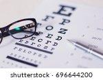 eye glasses and pen on eyesight ... | Shutterstock . vector #696644200