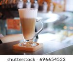 latte' coffee on counter   Shutterstock . vector #696654523