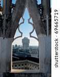 Panoramic view of Milan and Velasca Tower from the roof of the Duomo gothic cathedral, Lombardy, Italy - stock photo