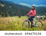 happy young woman riding a... | Shutterstock . vector #696670156