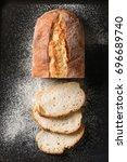 sliced homemade white wheat...   Shutterstock . vector #696689740