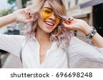 good looking curly girl with... | Shutterstock . vector #696698248