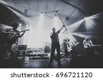 idles perform on a concert... | Shutterstock . vector #696721120
