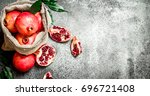 pomegranates in the old bag. on ... | Shutterstock . vector #696721408