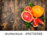 ripe grapefruits with leaves.... | Shutterstock . vector #696726568
