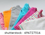 stack colored clothes on a...   Shutterstock . vector #696727516